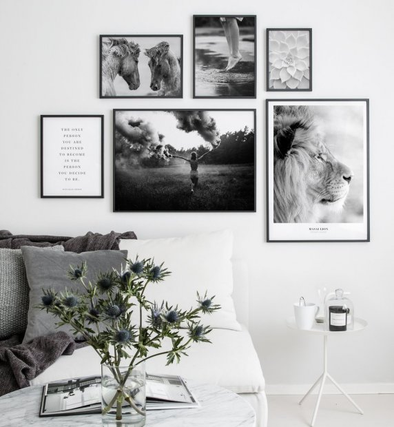 Gallery wall with black frames and black and white photo art