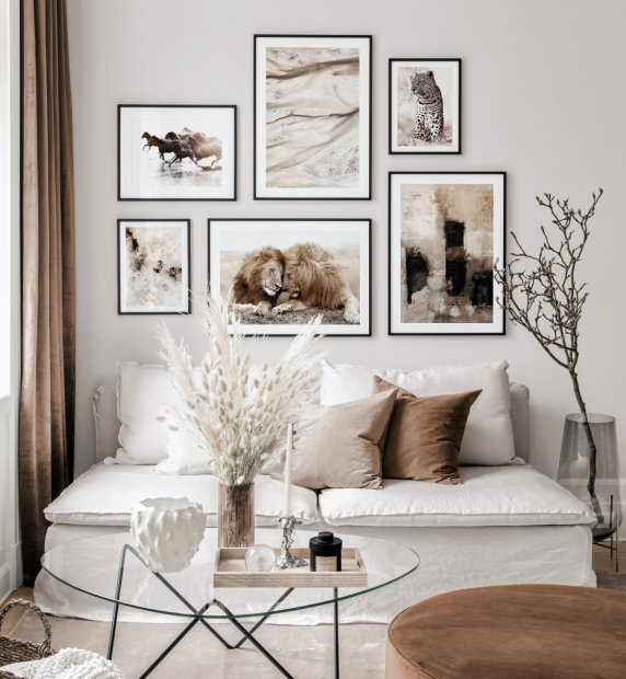 Brown gallery wall with animals posters and abstract posters in black wooden frames
