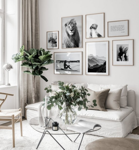 Black white gallery wall white interior oaken frames