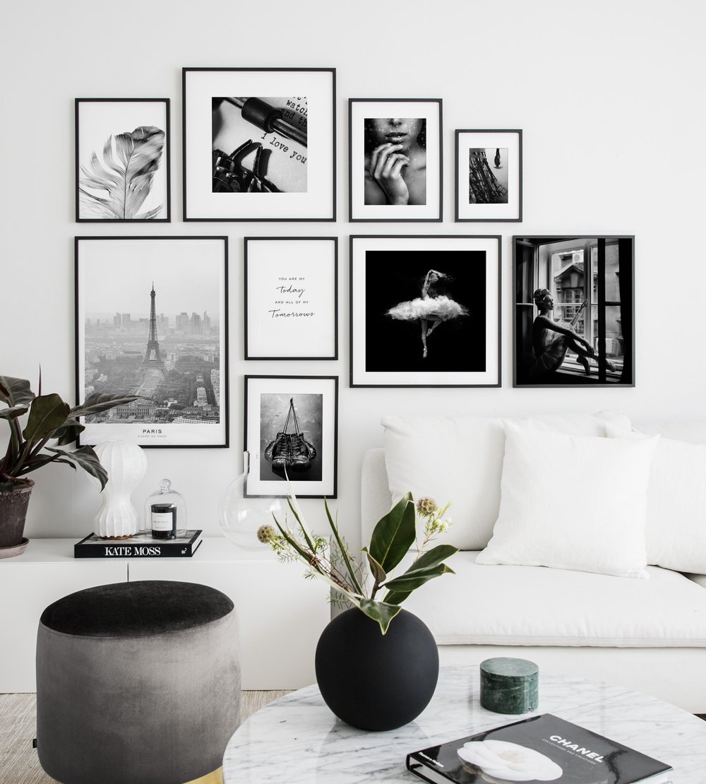 Gallery wall with black and white posters living room ...